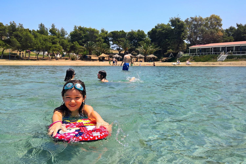 kids beach swim greece summer